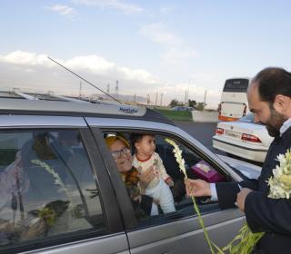 Welcoming of NOWRUZ passenger by holy shrine's custodian