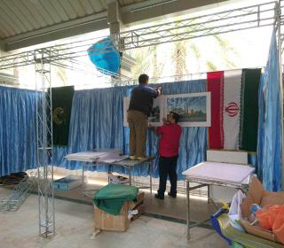 Preparing of holy shrine stand in international martyrdom exhibition( Karbala)